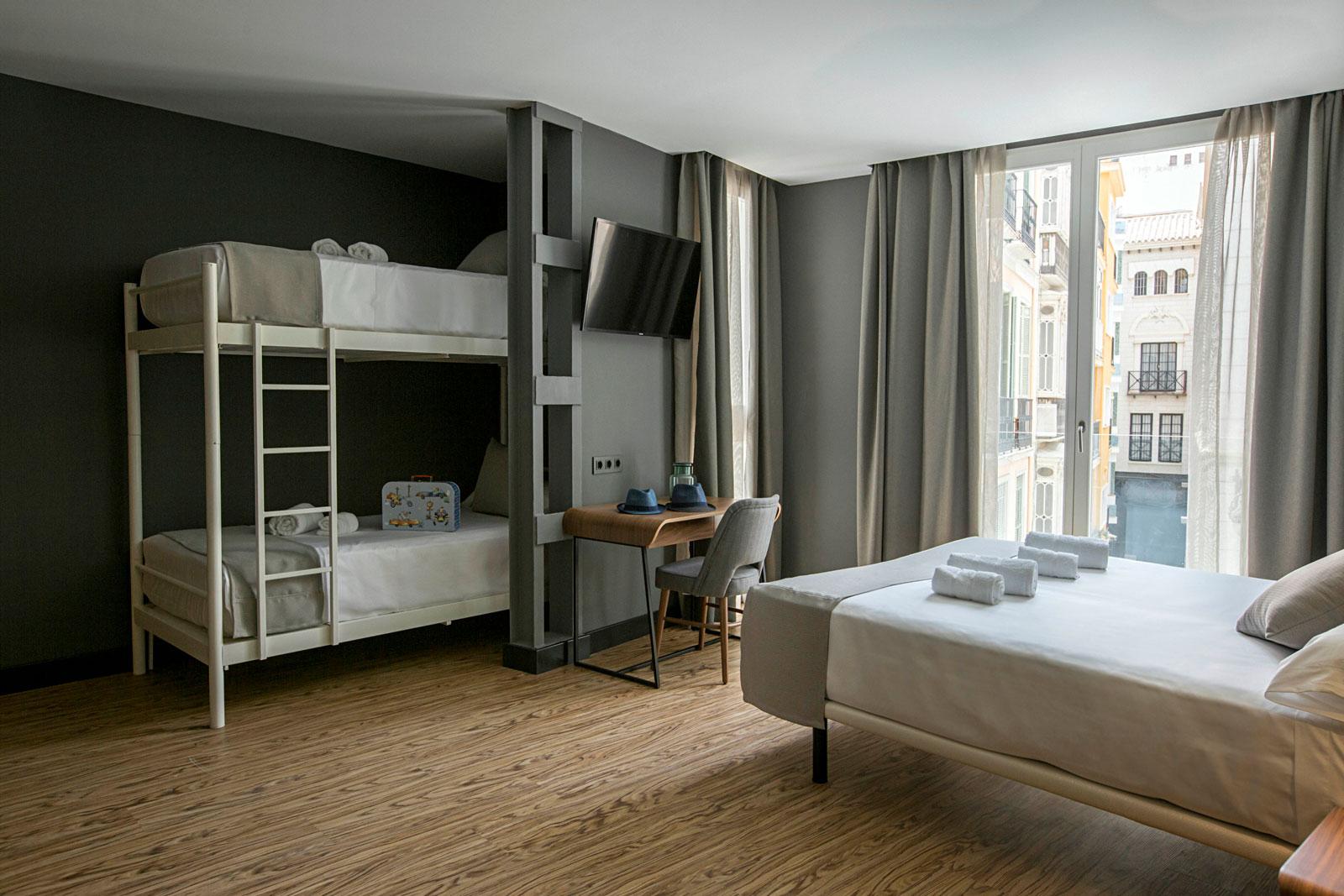 Hotel boutique habitaci n familiar en m laga premium hotel for Hotel malaga premium